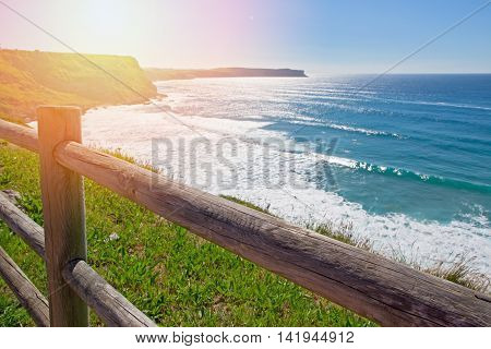 High steep ocean coast in summer day. Spain suburb of Suances summer day in the Province of Cantabria it is photographed from Playa de Los Locos.