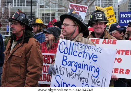 Sign Carrying Firefighters