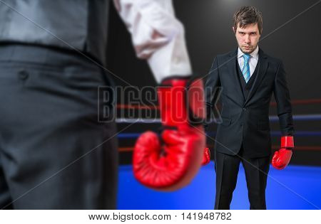 Businessman Is Fighting With His Boss In Boxing Ring.