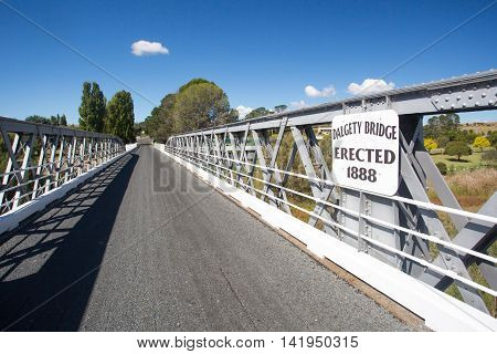 The iconic Dalgety Bridge built in 1888 serves as an important crossing over the Snowy River in New South Wales, Australia poster