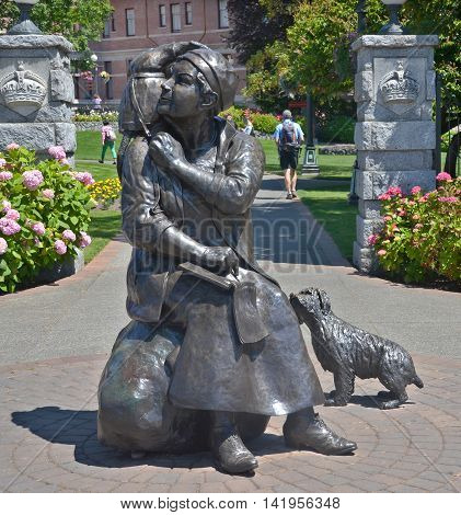 VICTORIA BC CANADA JUNE 22 2015: Bronze statue honors the renowned Canadian artist Emily Carr, ensuring that Victoria's famous citizen is commemorated in her hometown by sculptor Barbara Paterson
