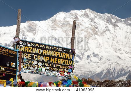 ANNAPURNA BASE CAMP NEPAL 12th APRIL 2016 - Mount Annapurna and Signboard in base camp round Annapurna circuit trekking trail Nepal
