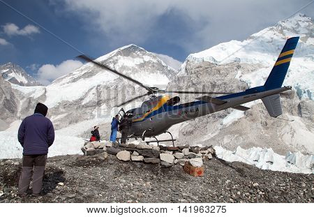 EVEREST BASE CAMP NEPAL 27th APRIL 2016 - helicopter in Mount Everest base camp and mount Nuptse Nepal