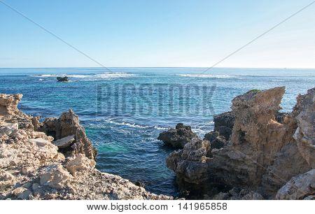 Turquoise Indian Ocean seascape and coastal limestone rock at Point Peron in Rockingham, Western Australia