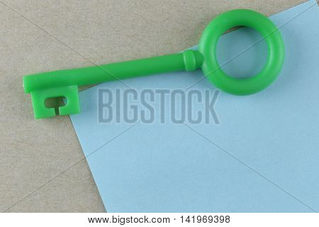 Green Plastic key is placed on Blue Paper Note and can input text to it.