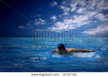 Beautiful blue sea with clouds and sunlight on sky and swimmer