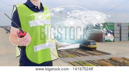 Global network coverage world map on tablet worker control container box loading from train at dock yard for Logistic Import Export background (Elements of this image furnished by NASA)
