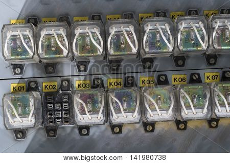 Row of old white Relay actuators with yellow marks