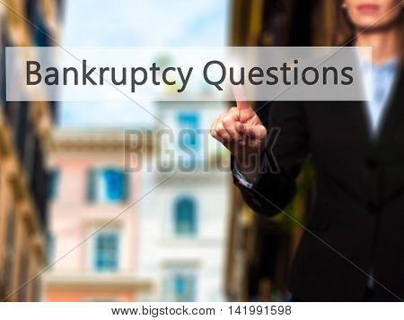 Bankruptcy Questions - Businesswoman Hand Pressing Button On Touch Screen Interface.