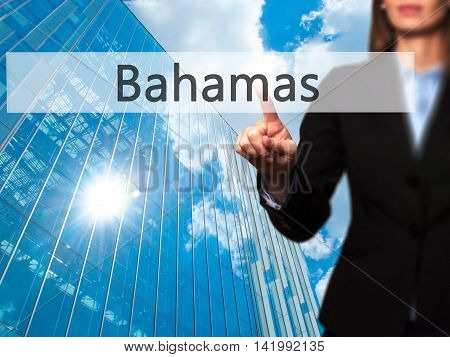Bahamas - Businesswoman Hand Pressing Button On Touch Screen Interface.