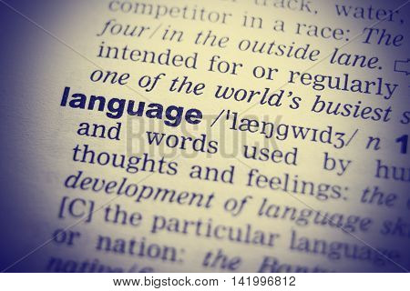 Language Dictionary Definition single word with soft focus.