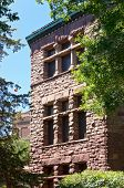 exterior facade of building in old campus historic district listed on national register of historic buildings at university of minnesota in richardsonian romanesque and queen anne architectural style poster