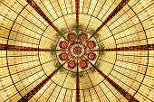 Yellow abstract chandalier - lower point of view. poster