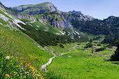 Idyllic mountain scene hiking in the mountains in a sunny day Austrian Alps Rofan Karwendel. poster