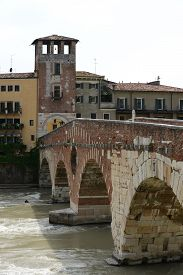 The Ponte Pietra known as the Pons Marmoreus is a Roman arch bridge crossing the Adige River in Verona Italy.