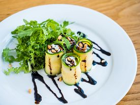 Zucchini Rolls With Mascarpone Cheese, Nuts, Green Salad And Soy Sauce