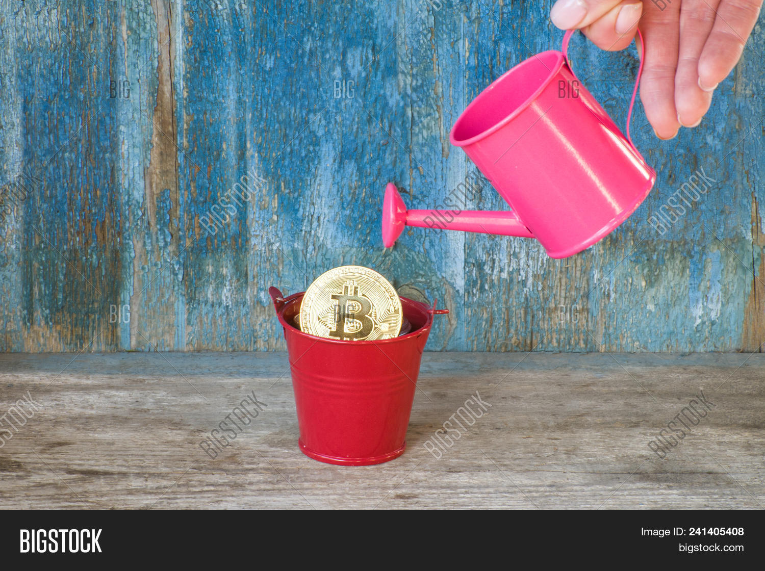 Little Watering Can In A Female Hand The Bitcoin Old Wooden Background Business