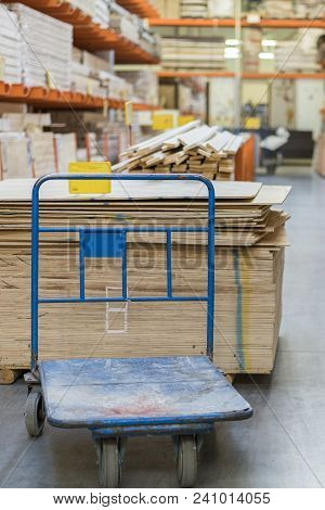 Shop Of Building Materials. Racks With Boards, Wood And Building Materials. Packed Boards In The Bui
