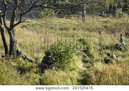The Military In The Forest With Weapons And In Military Uniforms Conduct Military Operations