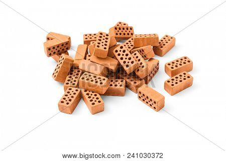A pile of miniature toy bricks on white background, including clipping path
