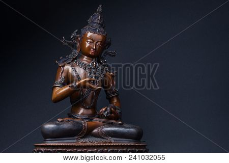 Vajrasattva With Dorje And Hand Bell On Black Background