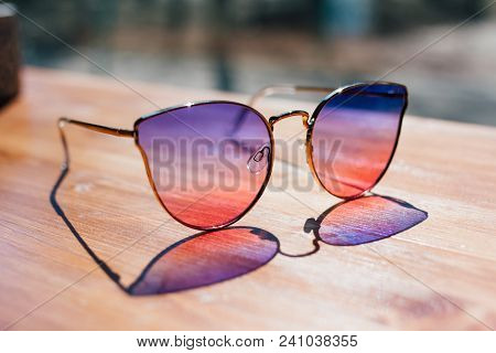 Sunglasses Lie On The Table
