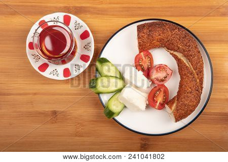 Breakfast With Feta Cheese,  Simit, Cucumber, Cherry Tomoto And Tea Isolated On Wooden Background To