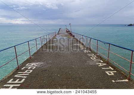 View From An Empty Pier Towards The Sea. Crimea, Spring, Early April. Cloudy. Translation Of The Wor