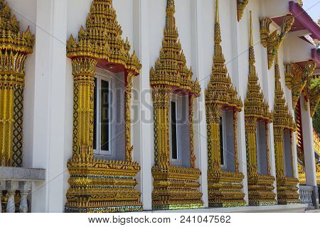 Wall Of  Buddhist Temple With Richly Decorated Windows, Decorated With Patterns, Gilding, Close-up,