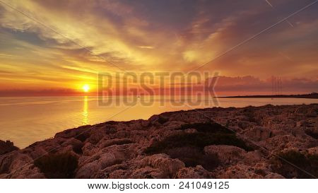 Cyprus Beautiful Sunrise With Rocks And Cloudy Colorful Sky, Natural Sea Panoramic Background