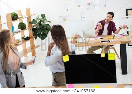 Multicultural Businesswomen Looking At Colleague At Workplace In Office