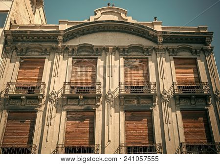 Old House With Wooden Shutters, Helping Escape Heat In Summer. Architecture Concept. Building In Old