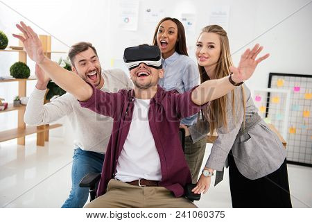 Cheerful Businessman In Vr Headset With Multicultural Colleagues Near By In Office