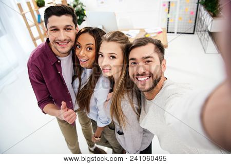 Camera Point Of View Of Happy Multicultural Business People Taking Selfie Together In Office