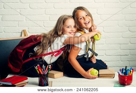 Back To School And Home Schooling. Little Girls Back To School At Knowledge Day
