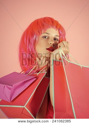 Sale And Black Friday. Woman With Shopping Bags. Fashion Shopper Posing On Pink Background. Girl Wea