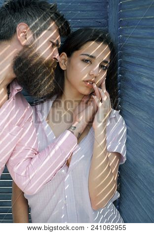 Heat Concept. Couple Chilling Near Jalousie, Stripes Of Sunlight And Shadow On Faces. Couple In Love