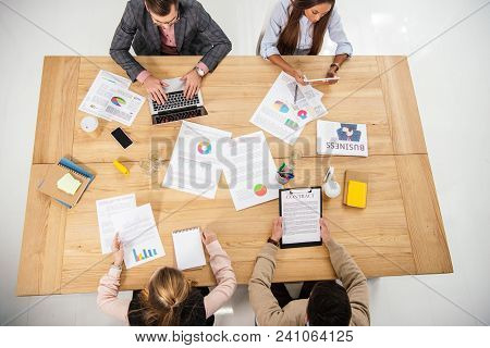 Overhead View Of Multicultural Business People Working At Table