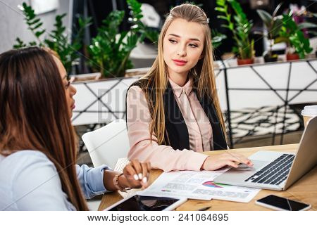 Portrait Of Young Multicultural Businesswomen Working Together In Office