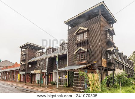 Howick, South Africa - March 23, 2018: Businesses In A Wooden Building At The Howick Falls In The Kw