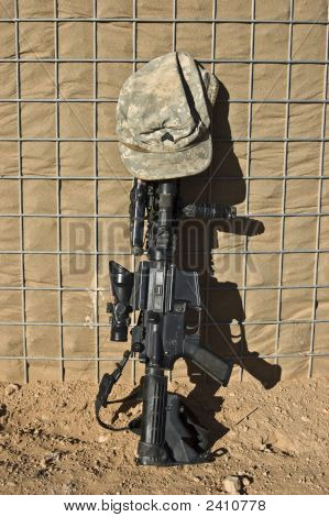 Rifle with Army ACU Hat