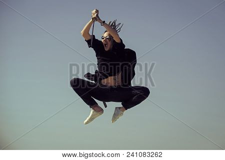 Defense, Power, Honor, Force. Man Samurai Jumping With Sword On Blue Sky. Concentration And Zen Conc