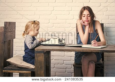 Kids Enyoj Happy Day. Girl And Child Sitting At Table. Young Woman Writing In Notebook. Kid Typing O