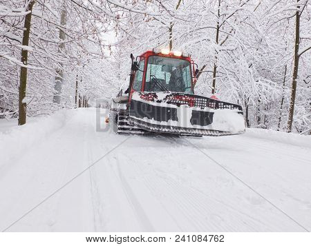 Snow Tractor Ratrack Is Preparing Ski Track In Moscow Park Winter Forest. Winter Ski Sports. Winter