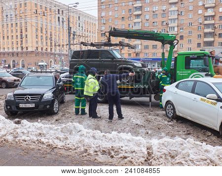 Moscow, Feb.6, 2018: Violation Of Cars Parking Rules Off Road Car Evacuated By Truck Vehicle Carrier