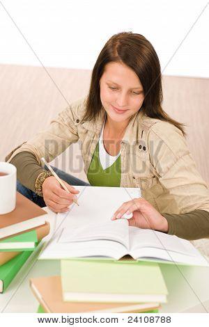 Student Teenager Girl Write Homework With Book