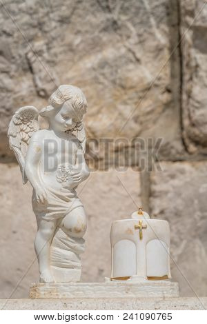 Tiny White Angel Boy Figure Sculpture With Wings, Dubrovnik