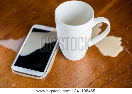 Coffee Is Spilled On This Cell Phone.