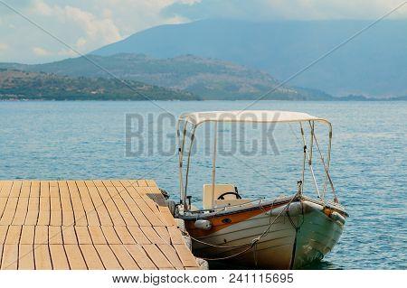 Motor Boats Drifting In The Deep Blue Sea On Croatian Coast.adriatic Sea Background.crystal Clear Wa