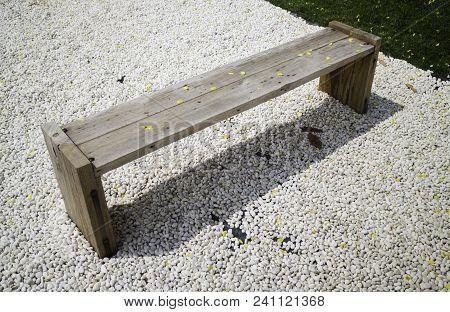 Wooden Bench In Rock Garden, Stock Photo